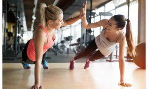 AdobeStock 123802422 Friends Workout Fitness Buddy Women Hi Five