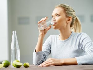 AN70 Woman drinking cup of water 732x549 Thumb